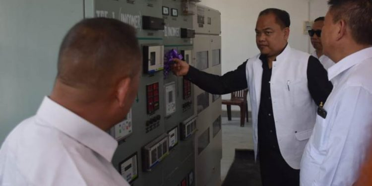 Adviser to Nagaland Power department Tovihoto Ayemi pressing a button to make operational the 3311 kv 2X10 MVA distribution sub-station in Dimapur on Monday.