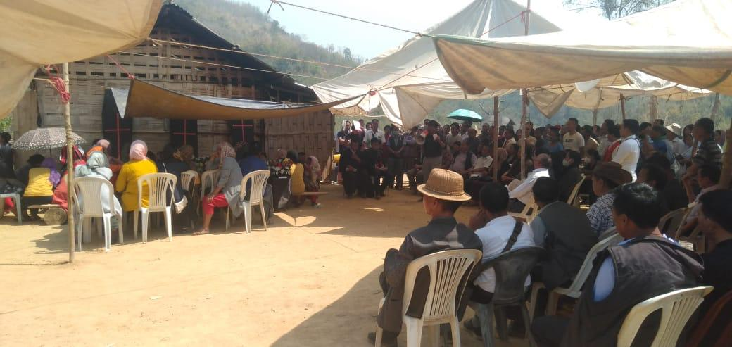 People attend the funeral service of the three persons killed at Lamhainamti in Peren district on Tuesday.