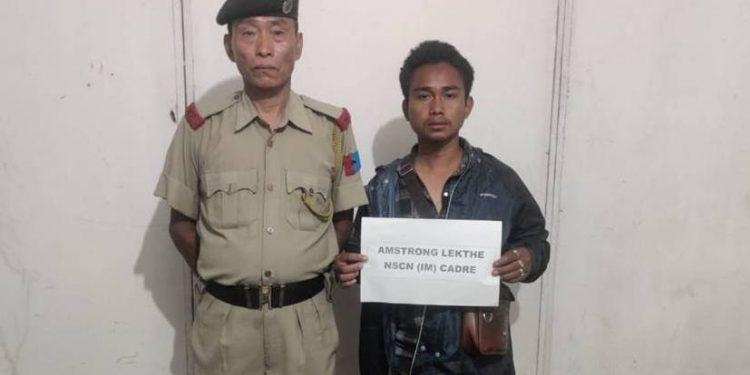 The apprehended cadre in police custody.