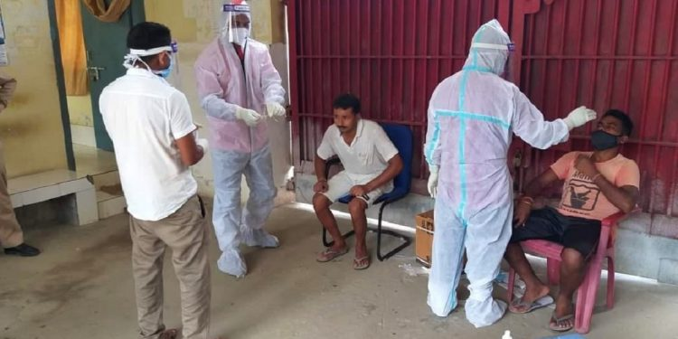 Health workers in protective suits taking nasal swabs of inmates in Udalguri district jail in Assam.