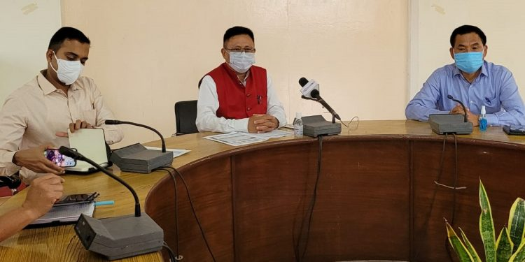 Nodal officer for Covid activities in Dimapur Y Kikheto Sema (centre) addressing a press conference in Dimapur on Wednesday. Photo Bhadra Gogoi