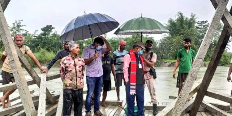 Dibrugarh MLA Prasanta Phukan taking stock of the rising water level of the Brahmaputra River.