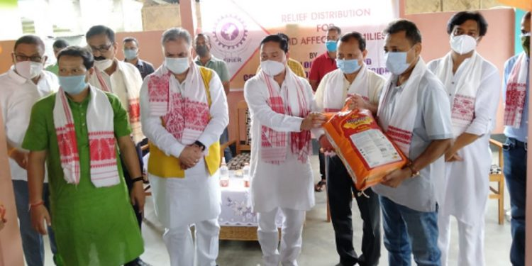 MP Dilip Saikia along with FINER President Pabitra Buragohain and FINER Director Aunpam Deka while distributing relief materials.