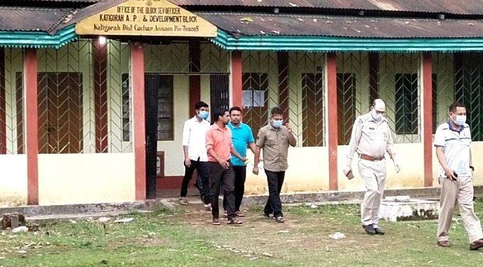 Hailakandi police escorting arrested BDO of Katigorah circle to the block development office on Sunday.