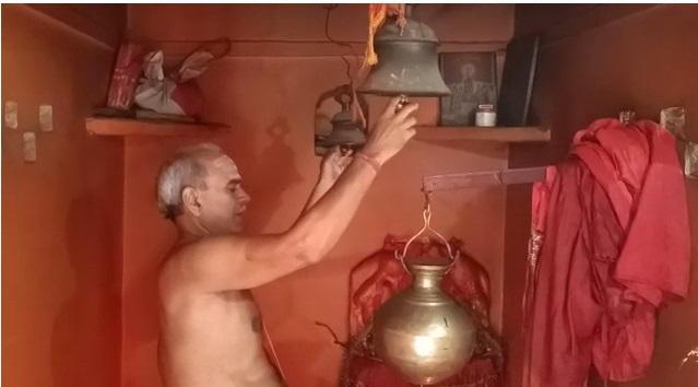 Tokyo Olympics bronze medalist winner team forward Lalit Upadhyaya's father Satish Upadhyaya praying for team's win at Shiva temple in his house in Bhagatpur (Varanasi).