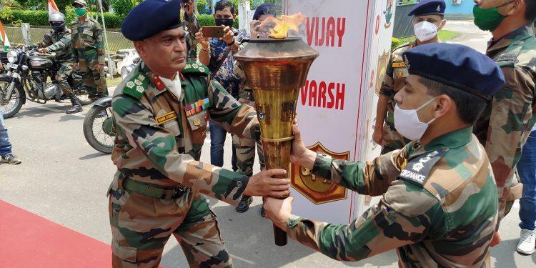 Narengi Military Station commander Brig SI D'Cunha receiving the Swarnim Vijay Mashaal.