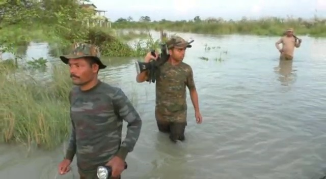 Forest guards in flooded Manas National Park. Image credit - Northeast Now