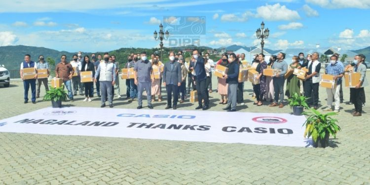 Music institutes and NGOs receiving Casio laser LED hybrid projectors from Nagaland chief minister Neiphiu Rio in Kohima on Monday.