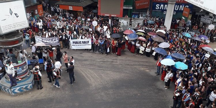 People at the rally against shifting of Dimapur DC's office at Holy Cross junction in Dimapur on Tuesday. Pic Bhadra Gogoi